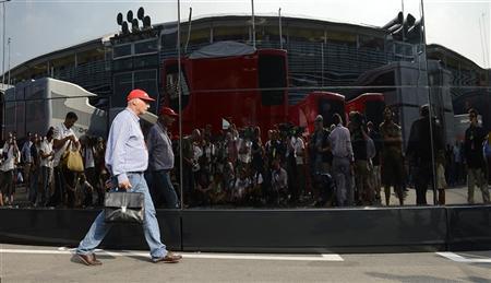 Former Austrian Formula One World Champion Niki Lauda walks in the paddock after the Italian F1 Grand Prix at the Monza circuit September 9, 2012. REUTERS/Giorgio Perottino