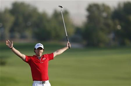 Rory McIlroy of Northern Ireland gestures at the 18th green after the fourth and final round of the DP World Tour Championship at Jumeirah Golf Estates in Dubai November 25, 2012. REUTERS/Jumana El Heloueh