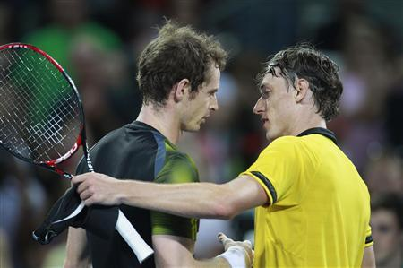 Andy Murray of Britain greets John Millman of Australia after their men's singles match at the Brisbane International tennis tournament January 3, 2013. REUTERS/Daniel Munoz