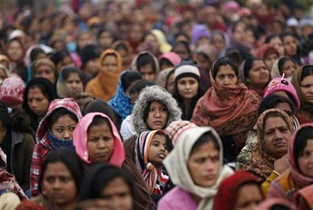 Women attend a prayer ceremony for a rape victim after a rally, organized by Delhi Chief Minister Sheila Dikshit (unseen), protesting for justice and security for women, at Raj Ghat in New Delhi January 2, 2013. REUTERS/Adnan Abidi (INDIA - Tags: CRIME LAW CIVIL UNREST POLITICS RELIGION)