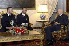 Italian President Giorgio Napolitano (R) meets two Italian marines Salvatore Girone (L) and Massimiliano Latorre (C) at Quirinale presidential palace in Rome, December 22, 2012. REUTERS/Press Officer Presidenza della Repubblica