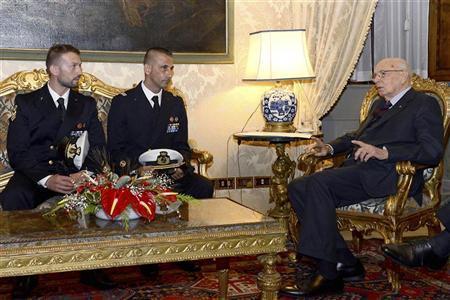 Italian President Giorgio Napolitano (R) meets two Italian marines Salvatore Girone (L) and Massimiliano Latorre (C) at Quirinale presidential palace in Rome, December 22, 2012. REUTERS/Press Officer Presidenza della Repubblica