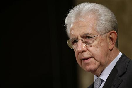 Italy's outgoing Prime Minister Mario Monti talks during a news conference in Rome December 28, 2012. REUTERS/Tony Gentile
