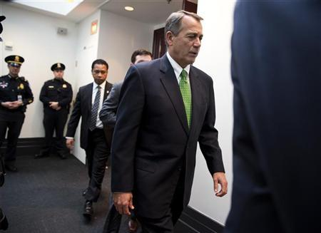 Speaker of the House John Boehner (R-OH) walks from a meeting with House Republicans about a solution for the ''fiscal cliff'' on Capitol Hill in Washington January 1, 2013. REUTERS/Joshua Roberts
