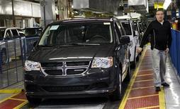A new 2011 Dodge Grand Caravan minivan is driven off the final production line during a celebration ceremony for the production launch of the new 2011 Dodge Grand Caravan and Chrysler Town & Country mnivans at the Windsor Assembly Plant in Windsor, Ontario January 18, 2011. REUTERS/Rebecca Cook