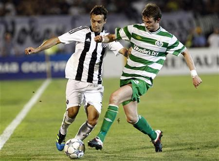 Nemanja Tomic of Partizan Belgrade (L) is challenged by Ronan Finn of Shamrock Rovers (R) during their Europa League second leg match in Belgrade August 25, 2011. REUTERS/Ivan Milutinovic