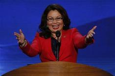 U.S. congressional candidate Tammy Duckworth (D-IL), former Assistant Secretary of the U.S. Department of Veterans Affairs, who lost both of her legs to injuries sustained while serving as a U.S. Army helicopter pilot in combat in Iraq, gestures as she addresses delegates during the first day of the Democratic National Convention in Charlotte, North Carolina, September 4, 2012. REUTERS/Jason Reed