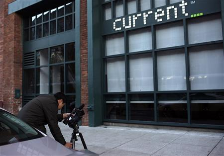 A journalist captures video of Current TV in San Francisco, California January 3, 2013. REUTERS/Robert Galbraith