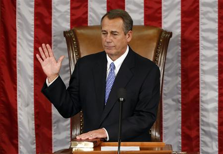Speaker of the House John Boehner takes his oath during the first day of the 113th Congress at the Capitol in Washington January 3, 2013. REUTERS/Kevin Lamarque