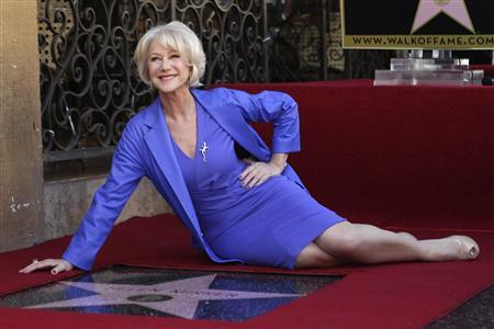 Helen Mirren poses with her newly-unveiled star, the 2,488th star on the Hollywood Walk of Fame, in Hollywood, California, January 3, 2013. The multi major award-winning actress was recently nominated for a Golden Globe Award by the Hollywood Foreign Press Association for Best Actress in a Motion Picture: Drama and for a Screen Actors Guild Award for Best Actress in a Motion Picture Drama. Mirren will appear in the HBO biopic ''Phil Spector'' later this year. REUTERS/David McNew