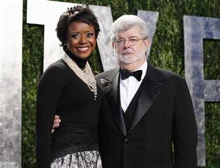 Director George Lucas and his partner Mellody Hobson arrive at the 2012 Vanity Fair Oscar party in West Hollywood, California in this February 26, 2012, file photo. Lucas has become engaged to his longtime girlfriend Hobson, according to media reports, January 3, 2013. REUTERS/Danny Moloshok/Files