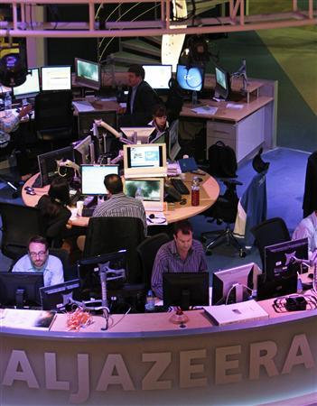 Employees of the English-language satellite news channel Al Jazeera work in the control room in Doha in this February 7, 2011 file photo. Al Jazeera said on January 3, 2013 it will buy Current TV, the struggling cable channel founded by Al Gore and partners, in a move that will boost the Qatar-based broadcaster's footprint in the United States. REUTERS/ Fadi Al-Assaad/Files