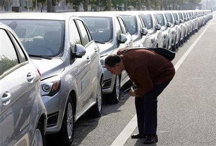 A visitor looks at a Beiqi E150EV car at the Beijing Electric Vehicle Company, in Beijing, in this file picture taken November 7, 2012. REUTERS/Jason Lee/Files