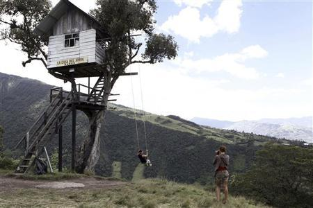 American tourists are seen at a tree house, which is used to observe Tungurahua volcano activity from 1.2 km (0.75 miles) of the volcano's crater in Banos city August 21, 2012. REUTERS/Gary Granja
