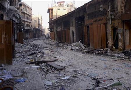 A view shows damaged buildings and shops in the old city of Aleppo, January 3, 2013, with members of the Syrian army patrolling in the distance. REUTERS/George Ourfalian (SYRIA - Tags: CONFLICT)