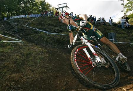 Burry Stander of South Africa cycles during the men's cross country at the UCI Mountain Bike World Championships in Mount Ste-Anne, Beaupre, September 4, 2010. REUTERS/Mathieu Belanger