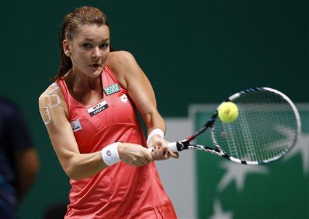 Poland's Agnieszka Radwanska hits a return to Serena Williams of the U.S. during their semifinals WTA tennis championships match in Istanbul, October 27, 2012. REUTERS/Osman Orsal