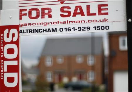 A sold sign hangs from a for sale board on a housing development in Manchester, northern England June 7, 2011. REUTERS/Phil Noble