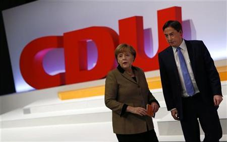 Angela Merkel, German Chancellor and leader of the Christian Democratic Union party CDU and Lower Saxony federal state prime minister David McAllister arrive for the second day of the CDU's party congress in Hanover, December 5, 2012. REUTERS/Kai Pfaffenbach (GERMANY - Tags: POLITICS)