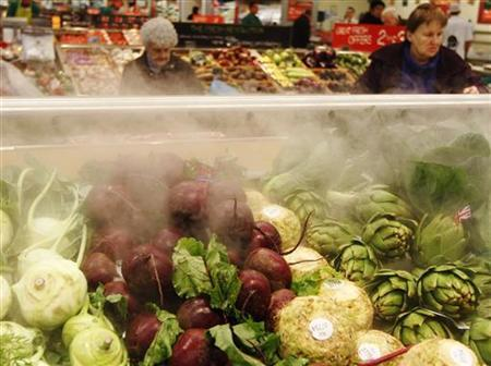 Shoppers browse among vegetables at a Morrisons supermarket store in London November 21, 2012. REUTERS/Luke MacGregor