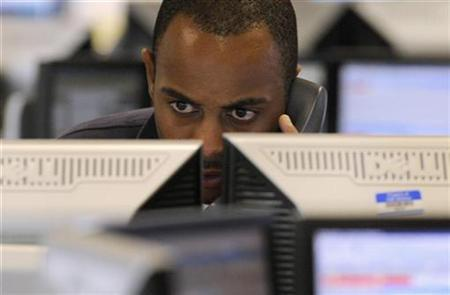 A dealer works on the trading floor at CMC Markets in London October 3, 2008. REUTERS/Toby Melville/Files