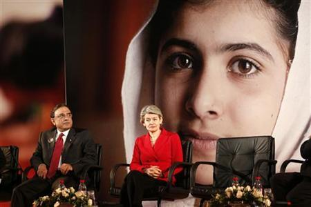 Pakistan's President Asif Ali Zardari (L) and UNESCO Director-General Irina Bokova attend the event ''Stand up for Malala, Girls' education is a right!'' during the United Nations Human Rights Day at the UNESCO headquarters in Paris December 10, 2012. REUTERS/Charles Platiau (FRANCE - Tags: POLITICS)