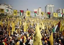 Palestinians take part in a rally marking the 48th anniversary of the founding of the Fatah movement, in Gaza City January 4, 2013. REUTERS/Suhaib Salem