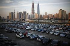 A parking lot is seen along the Huangpu River near the financial district of Pudong in Shanghai, in this file picture taken December 12, 2012. Automakers in China are bracing for another year of tepid single-digit growth in 2013, weighed down by sluggish demand for Japanese cars amid a diplomatic row between the two regional neighbours and government measures intended to restrict traffic in bigger cities. REUTERS/Carlos Barria/Files