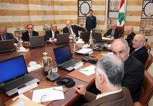 Lebanon's President Michel Suleiman (5th from bottom) presides a cabinet meeting at the presidential palace in Baabda, near Beirut January 3, 2013. REUTERS/Dalati Nohra/Handout