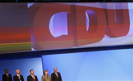 The leadership team of Germany's Christian Democratic Union (CDU) sings the national anthem at the end of the CDU's annual party meeting in Hanover, December 5, 2012. REUTERS/Kai Pfaffenbach