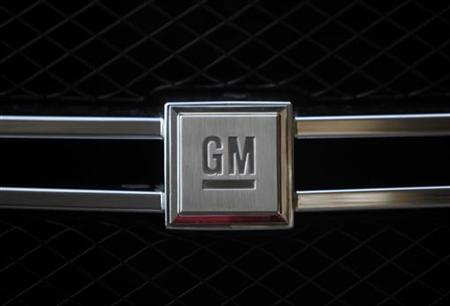A GM logo is seen on a Hydrogen car during a presentation in Berlin, August 28, 2009. REUTERS/Pawel Kopczynski/Files
