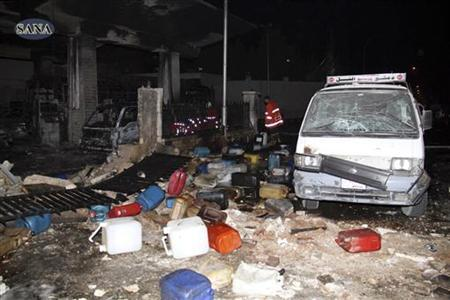 Wreckage and debris are seen after a car bomb exploded at a crowded petrol station in Barzeh al-Balad district in Damascus, in this handout photograph released by Syria's national news agency SANA on January 3, 2013. REUTERS/Sana