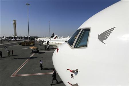 The nose of an Airbus corporate jet is seen near the control tower of Al Maktoum International Airport at Dubai World Central during the first day of the Middle East Business Aviation show, December 11, 2012. REUTERS/Jumana El Heloueh
