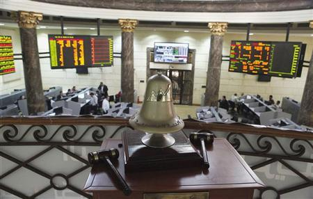 The opening bell is seen as traders work at the Egyptian stock exchange in Cairo January 3, 2013. Egypt's stock market held up well this week despite a weak currency, as foreign investors continued to buy shares - a sign that a devaluation of Egypt's pound, which looks increasingly likely, might not be a disaster for financial markets. REUTERS/Asmaa Waguih (EGYPT - Tags: BUSINESS)