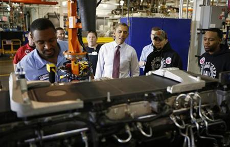 U.S. President Barack Obama watches on as a turbocharger is attached to a diesel engine under construction as he tours the Daimler Detroit Diesel plant in Redford, Michigan, December 10, 2012. REUTERS/Jason Reed