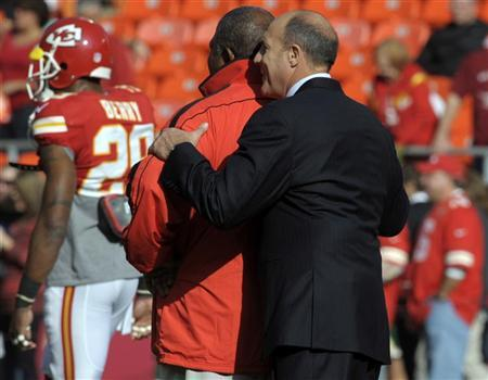 Kansas City Chiefs head coach Romeo Crennel (L) is hugged by general manager Scott Pioli before the start of their NFL game against the Carolina Panthers December 2, 2012. REUTERS/Dave Kaup