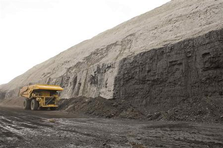 A haul truck is pictured at a coal seam at a coal mine in the Powder River Basin in Wyoming in this undated handout photo obtained by Reuters November 30,2012. REUTERS/National Mining Association/Handout