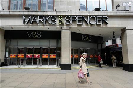 A woman walks out of the Marble Arch branch of Marks and Spencer in central London June 8, 2012. REUTERS/Paul Hackett