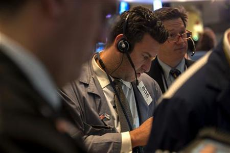 Traders work on the floor of the New York Stock Exchange in New York, January 2, 2013. REUTERS/Keith Bedford