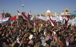 Iraqi Sunni Muslims wave national flags and chant slogans during an anti-government demonstration in Tikrit, 150 km (93 miles) north of Baghdad, January 4, 2013. The protesters were demanding the release of Sunni detainees in government prisons and called for major reforms against corruption in the government. REUTERS/Bakr al-Azzawi