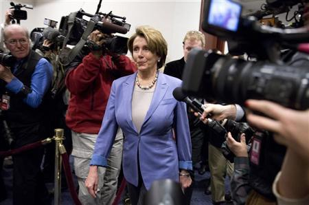 U.S. House Minority Leader Nancy Pelosi (D-CA) arrives to meet with House Democrats and U.S. Vice President Joseph Biden about a solution for the ''fiscal cliff'' on Capitol Hill in Washington January 1, 2013. REUTERS/Joshua Roberts