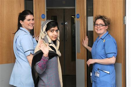 Pakistani schoolgirl Malala Yousufzai (C) waves with nurses as she is discharged from The Queen Elizabeth Hospital in Birmingham in this handout photograph released on January 4, 2013. REUTERS/Queen Elizabeth Hospital Birmingham/Handout