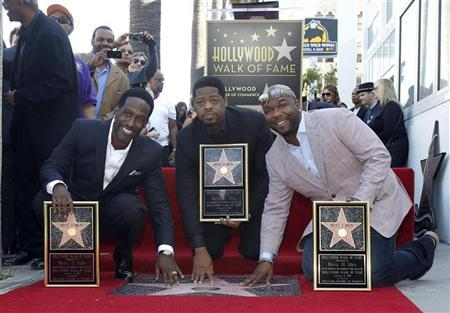Shawn Stockman (L), Nathan Morris (C) and Wanya Morris of R&B group Boyz II Men pose after unveiling their star on the Walk of Fame in Hollywood, California January 5, 2012. REUTERS/Mario Anzuoni
