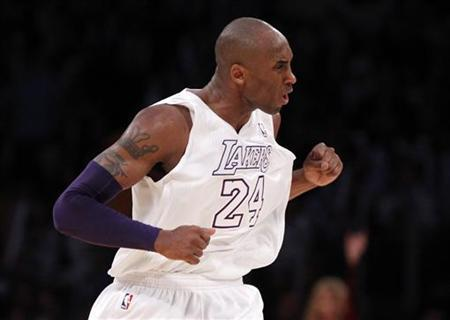 Los Angeles Lakers' Kobe Bryant celebrates after scoring against the New York Knicks during the second half of their NBA basketball game in Los Angeles December 25, 2012. REUTERS/Danny Moloshok/Files