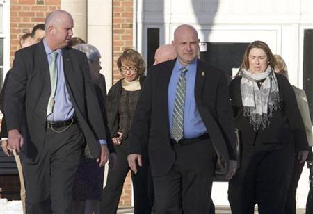 Former U.S. Representative Gabrielle Giffords (2nd L, in glasses) leaves the Newtown Municipal Building in Newtown, Connecticut January 4, 2013. REUTERS/ Michelle McLoughlin