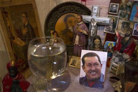 A picture of Venezuela's President Hugo Chavez rests on a religious altar in Caracas January 3, 2013. REUTERS/Carlos Garcia Rawlins