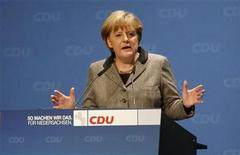 German Chancellor and Christian Democratic Union (CDU) party leader Angela Merkel gestures as she speaks during a new years party meeting of the Wilhelmshaven - CDU, in Wilhelmshaven January 4, 2013. A regional election will be held on January 20 in Lower Saxony state, with Merkel's conservatives fighting to prevent a loss of local power to their Social Democrat rivals that could dent the chancellor's 2013 re-election hopes. REUTERS/Morris Mac Matzen (GERMANY - Tags: POLITICS)