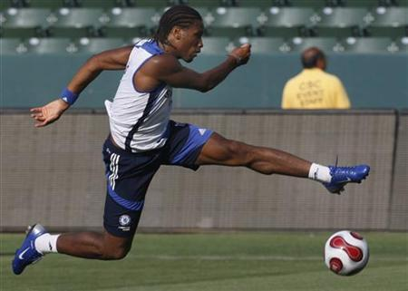 Didier Drogba trains at a soccer practice session at the home of L.A. Galaxy, The Home Depot Center, at Carson in California, July 16, 2007. REUTERS/Toby Melville/Files