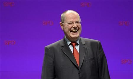 Peer Steinbrueck, Social Demrocratic (SPD) top candidate for the 2013 German general elections laughs after his speech during an election campaign with Lower Saxony's Social Democratic top candidate Stephan Weil (not pictured) in Emden, January 4, 2013. State elections in Lower Saxony will be held on January 20. REUTERS/Fabian Bimmer (GERMANY - Tags: POLITICS)