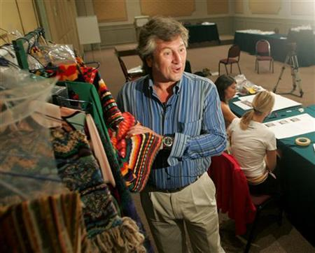 Vittorio Missoni speaks during an interview with Reuters in Lima, December 15, 2004. REUTERS/Mariana Bazo/Files